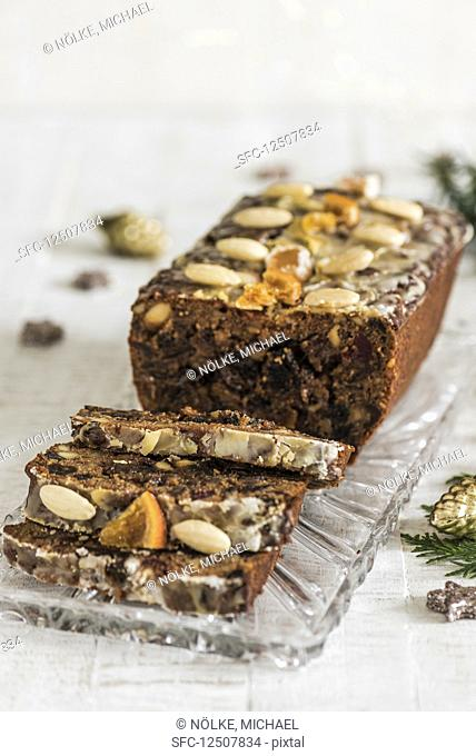 Fruit bread, sliced on a glass platter (Christmas)
