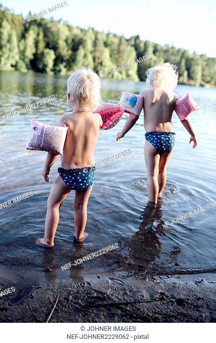 Girls playing in lake