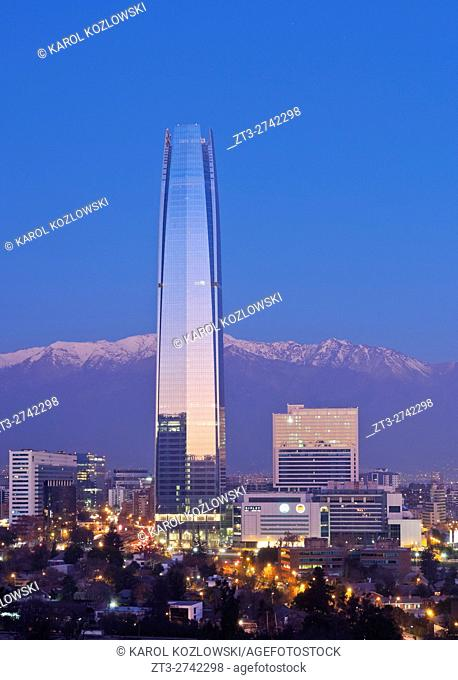 Chile, Santiago, Twilight view from the Parque Metropolitano towards the high raised buildings with Costanera Center Tower