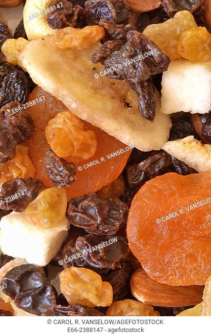 Healthy snacks: bowl of various dried fruits. Closeup