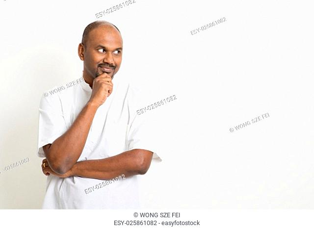 e8f3504ac Portrait of mature casual business Indian man looking side and smiling