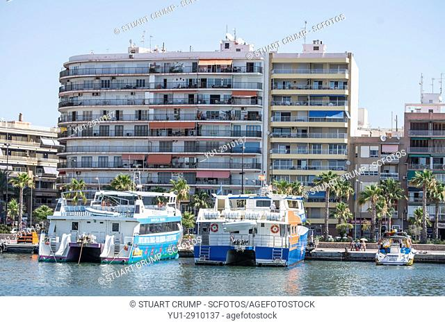 Tourist boats for the island of Tabarca moared in the harbour of Santa Pola in Alicante Spain