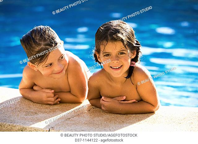Two caucasian girls in the swimming pool