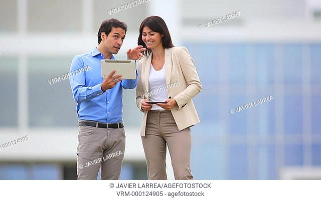 businesswoman and businessman with tablet and smartphone in business center. San Sebastian Technology Park. Donostia. Gipuzkoa. Basque Country. Spain