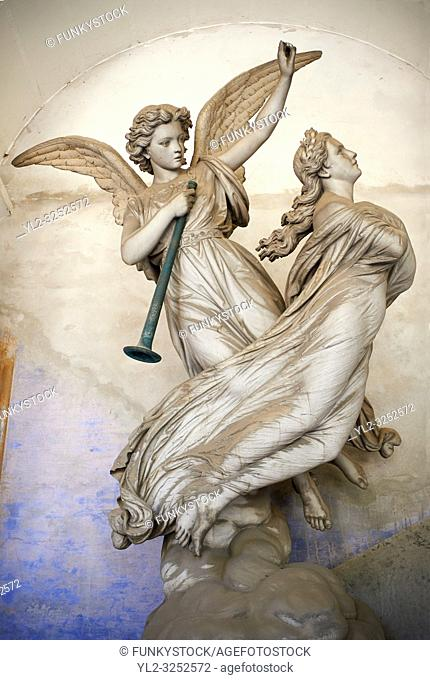 Picture and image of an angel guiding a women to heaven stone sculpture on the Piaggio tomb sulpted by Fabian Federico 1876