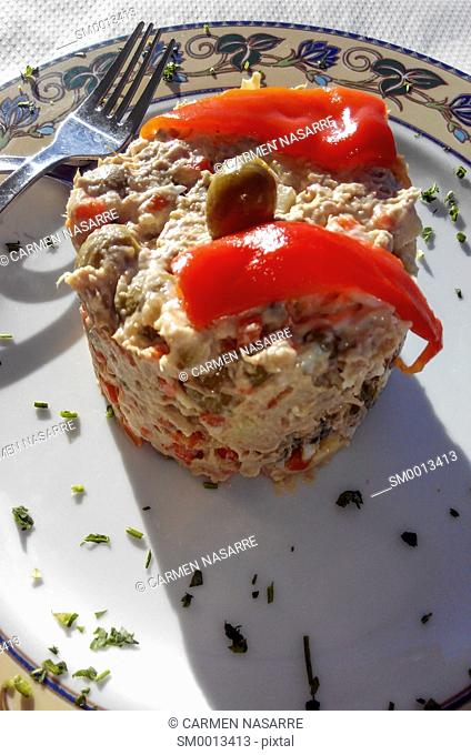 Russian salad dish with red peppers