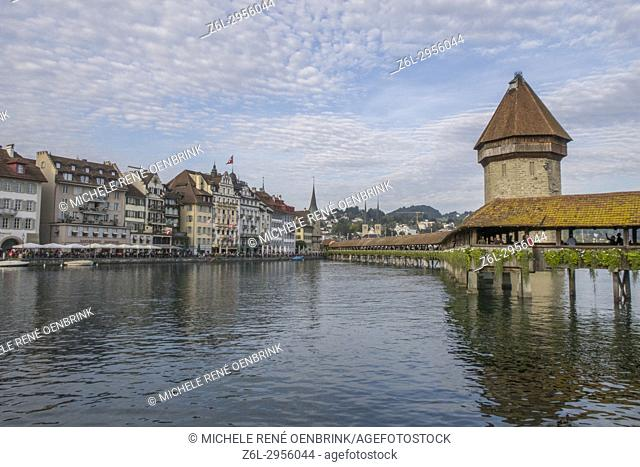 Lake Lucerne Switzerland famous walking bridge and swans in river during the fall season