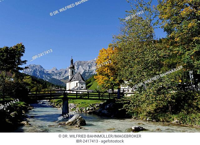 Parish Church of Saint Sebastian and the Ramsau river in front of the Reiteralpe or Reiter Alm mountains, Ramsau, Berchtesgadener Land district, Upper Bavaria