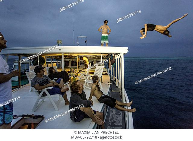 Boy is jumping from boat