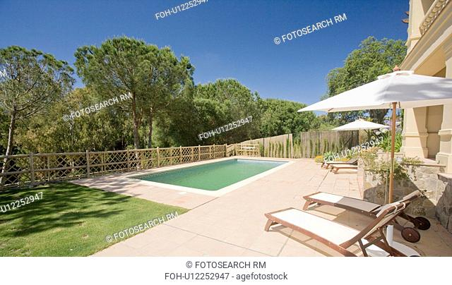 Rear of villa in Southern Spain overlooking pool and woodland beyond