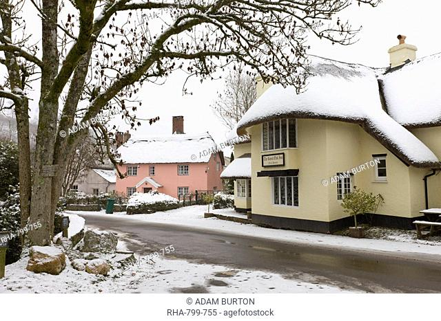 Snow covered country pub and cottages in the village of Winsford in winter, Exmoor National Park, Somerset, England, United Kingdom, Europe