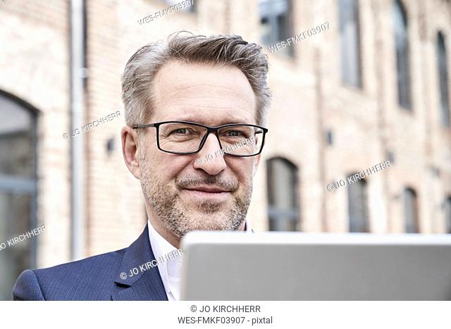 Portrait of businessman with tablet