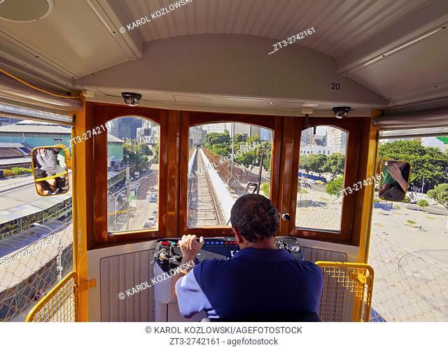 Brazil, City of Rio de Janeiro, Lapa, Yellow Tram crossing the Carioca Aqueduct known as Arcos da Lapa
