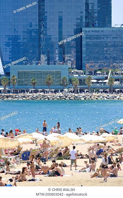 Sunbathing people Sant Sebastia beach tourists