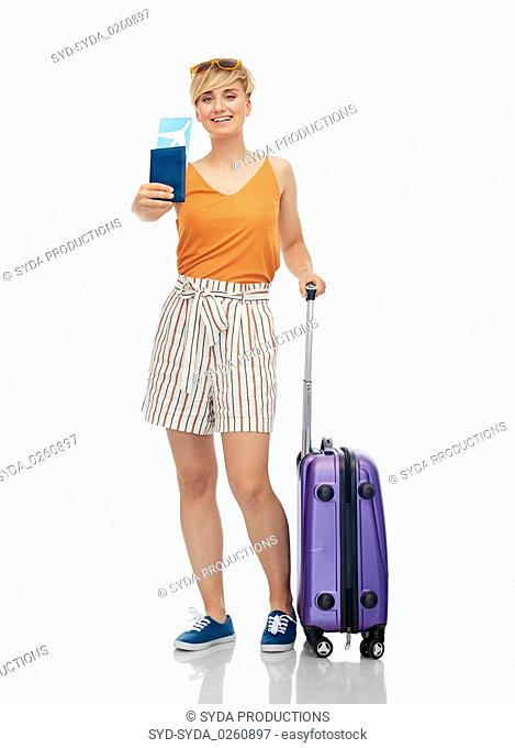 smiling teenage girl with travel bag and air ticket