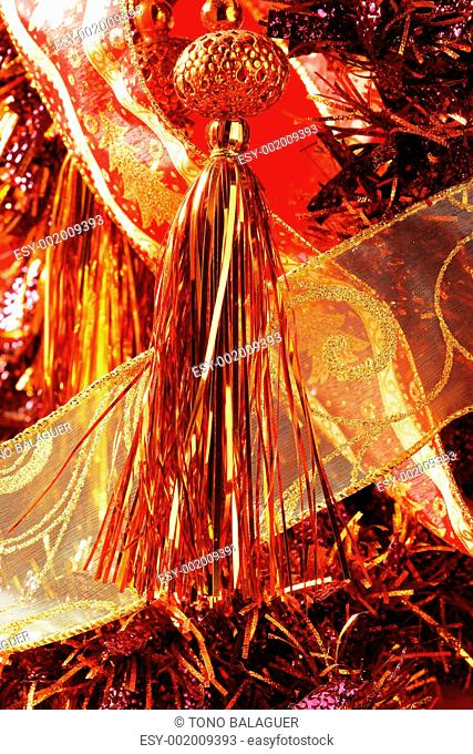 Golden christmas macro decoration, red background