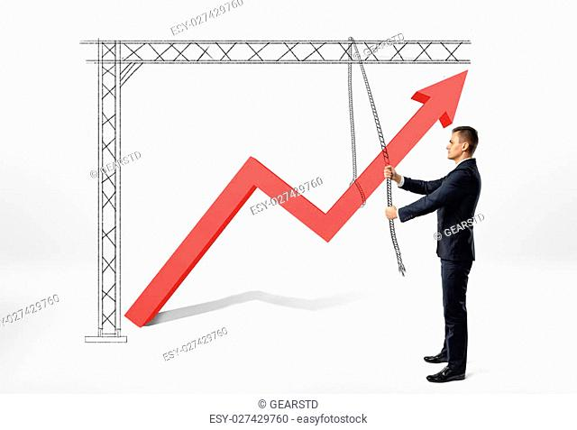 Businessman pulls big red arrow with drawing pulley on white background. Profit and benefit. All in your hands. Earning money. Development and success