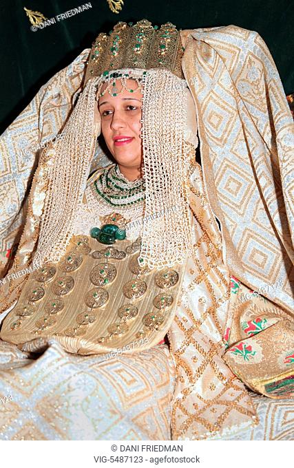 A Moroccan Arab bride dressed in traditional attire during her wedding in Fez (Fes), Morocco, Africa. (This image has a signed model release)