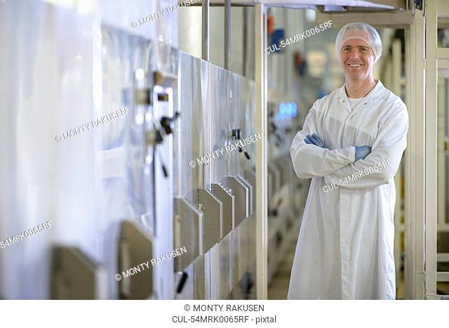 Worker smiling in biscuit factory
