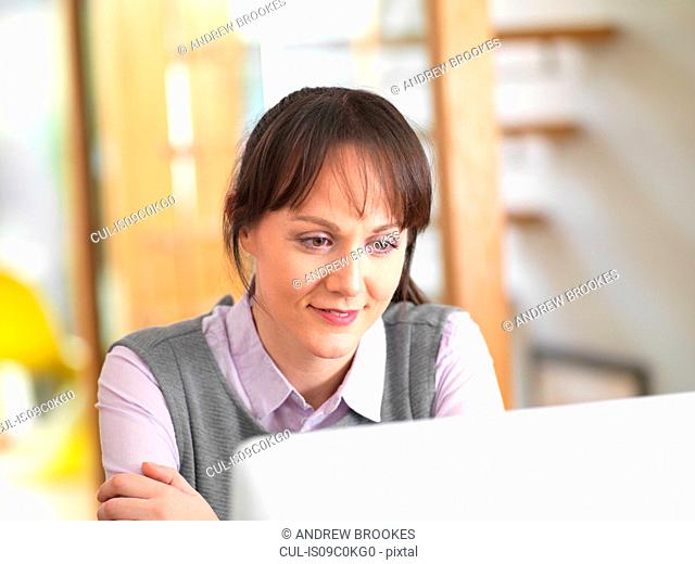 Woman viewing reports on a computer