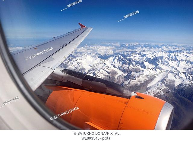 airplane flying over the Alps