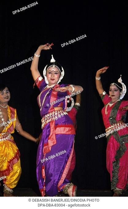 woman performing indian classical odissi dance , india , MR