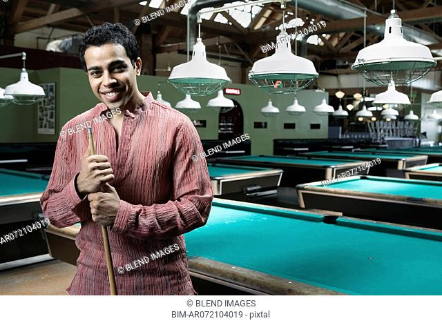 Portrait of man in pool hall