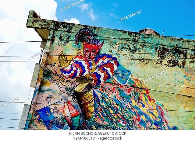 A colorful mural showing the Afro-Cuban religious motive a drummer painted on house in Santiago de Cuba, Cuba, August 1, 2009  The Palo religion Las Reglas de...