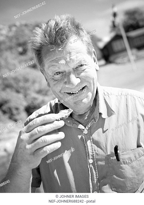 A man eating oysters, Sweden