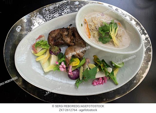 Chef Bo Songvisava, the best woman chef in Asia in her restaurant Bo Lan in Bangkok. Thailand. Duck rousted and relish of salty duck egg simmered in coconut...