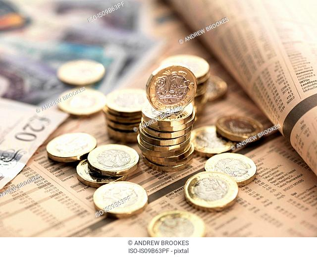 Still life of British currency on financial newspaper, close-up