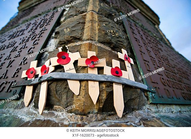 Small remembrance crosses laid in memory tribute at Aberystwyth War Memorial Wales UK