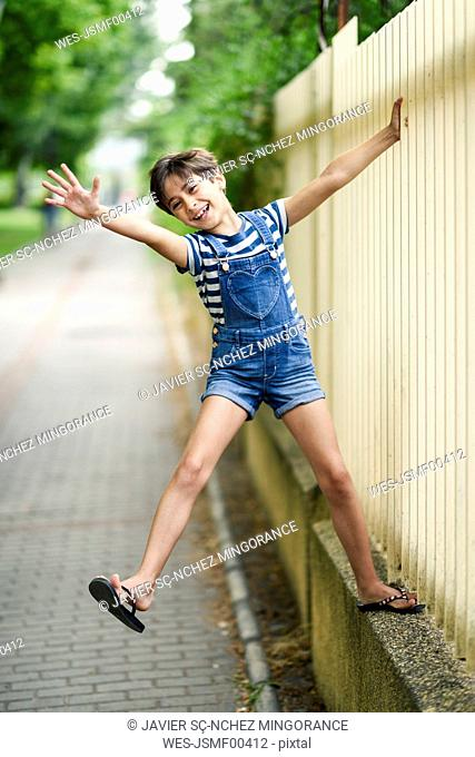 Portrait of laughing little girl playing outdoors