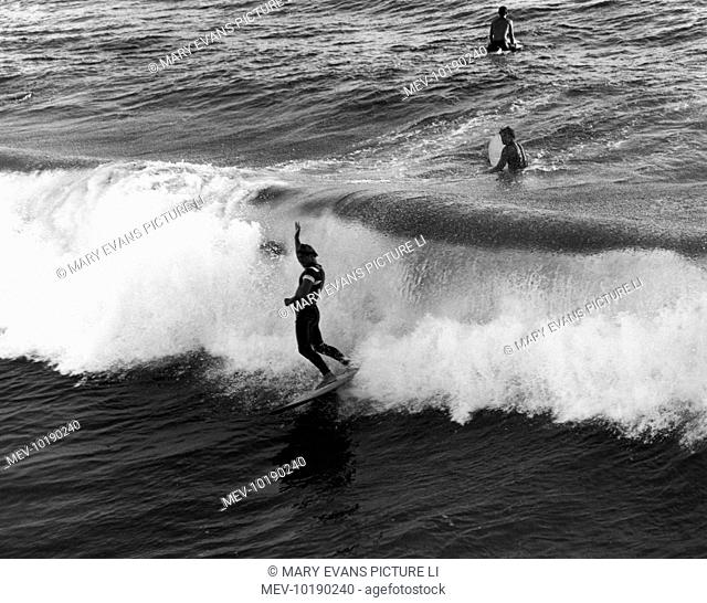 Surfing at Pismo Beach, south California, U.S.A