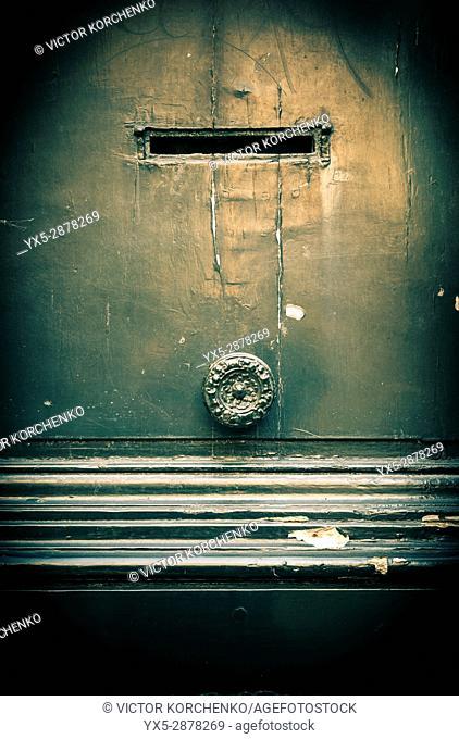 Old door with mailbox slot