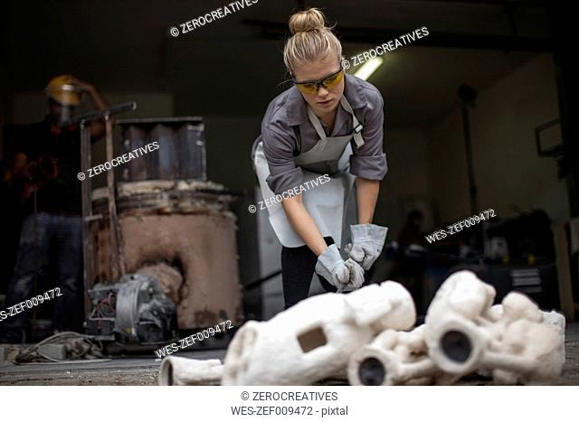 Woman with casts in workshop