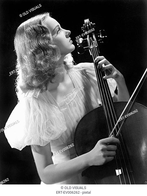Young woman playing a cello All persons depicted are not longer living and no estate exists Supplier warranties that there will be no model release issues