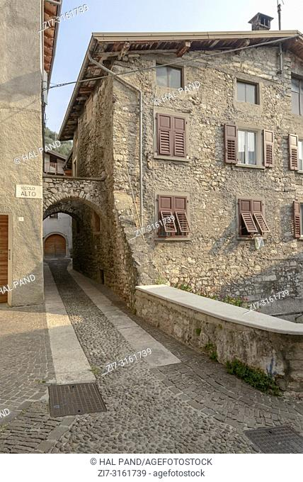 cityscape with old stone houses in little historical town , shot in bright fall light at Arco, Trento, Italy