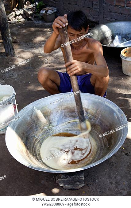 Man Stirring and Making Palm Sugar in Village of Preah Dak in Siem Reap in Cambodia