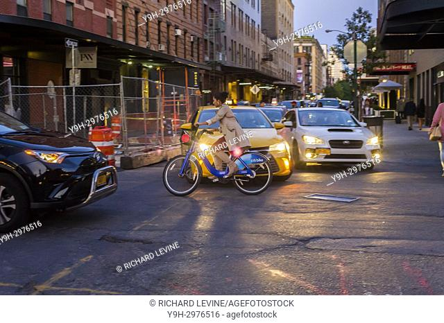 A woman rides her CitiBike through traffic in the Meatpacking district in New York on Saturday, September 9, 2017. (© Richard B. Levine)