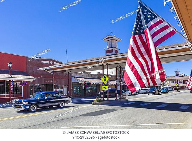 American flag with covered crosswalk in background on Cottage Ave in downtown area of Cashmere a city in Chelan County, Washington, United States
