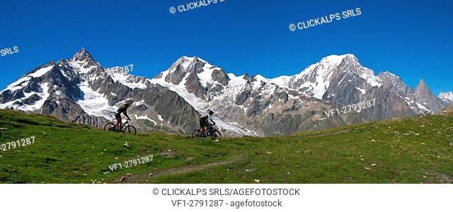 Mountain bike on the Alps, Col Chavannes, (Aiguille de Glacier, Aiguille de trelatete, Mont Blanc (Monte Bianco) on backgorund), Veny Valley, Italy, Europe