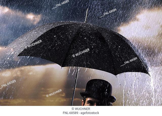 Close-up of man holding umbrella