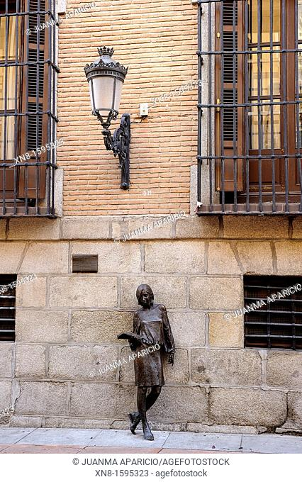 After Julia, name of the bronze statue depicting a life-size student against the wall, made for the artist Antonio Santin, situated in Fish Street in Madrid