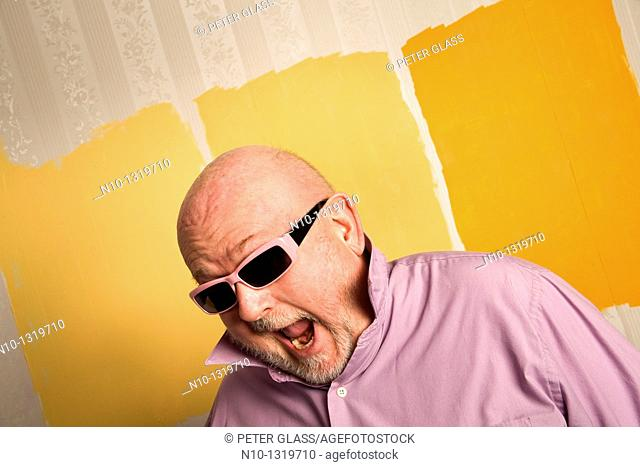 Middle-age balding man wearing sunglasses