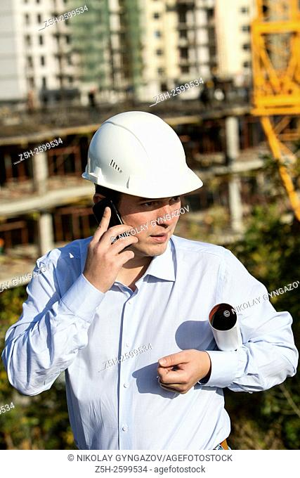 Russian Federation. Belgorod. Young engineer on a construction site