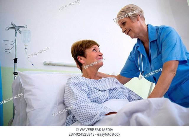 Nurse talking to a senior patient