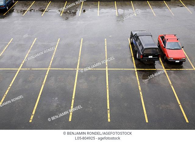 View of parking spaces in the rain, Canada