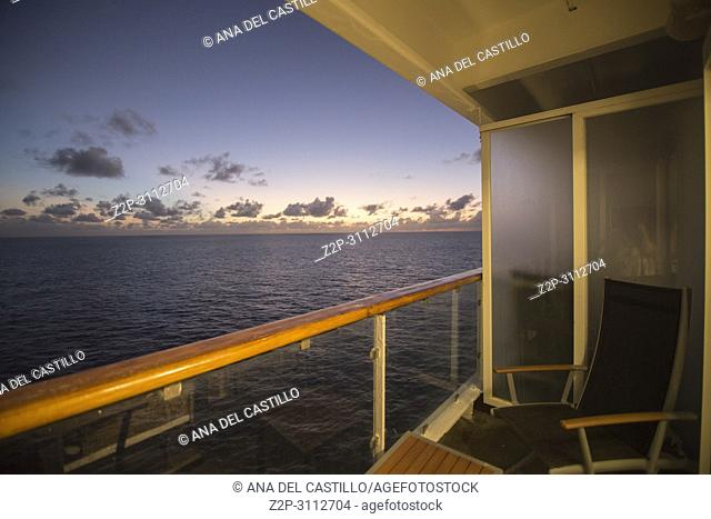 Sunset over the Caribbean sea from a cabin in cruise ship