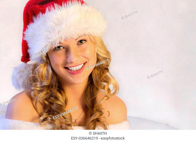 Young beautiful woman in red christmas wear